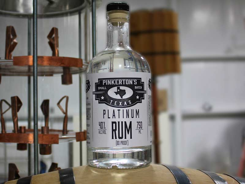 Our History begins with the Pinkerton's Distillery Platinum rum bottle in the distillery